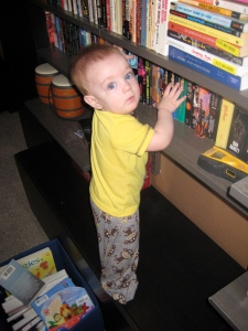 Lucas climbing the shelves