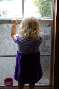 Kyla watching the rain