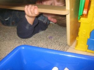 Hiding from Daddy.  He's good!